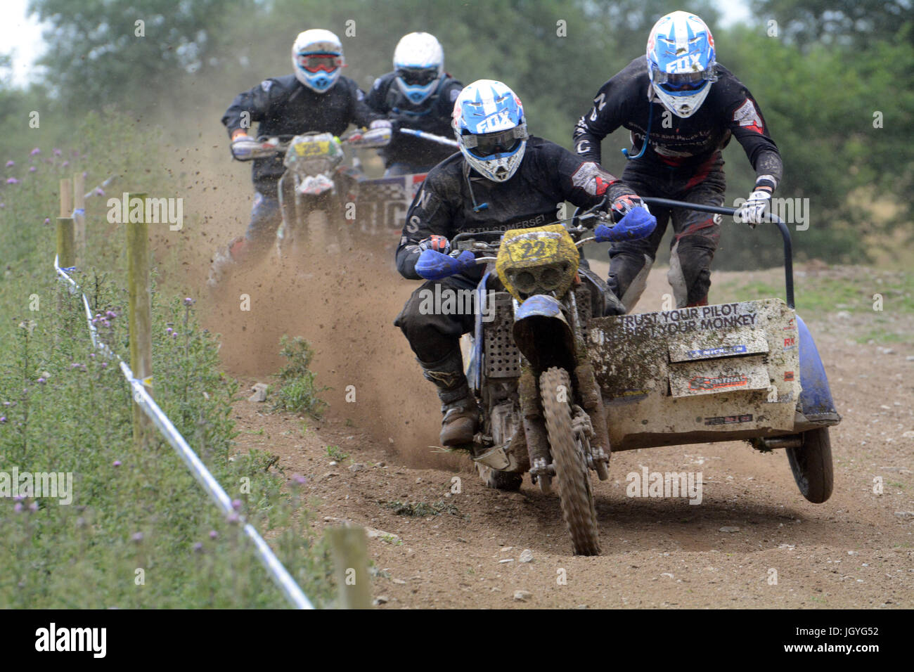 Simon Chilcott and Ben Sinclair(22) and Mark Stokes and Philip Gostling(25) in the sidecar clubman class of the - Stock Image