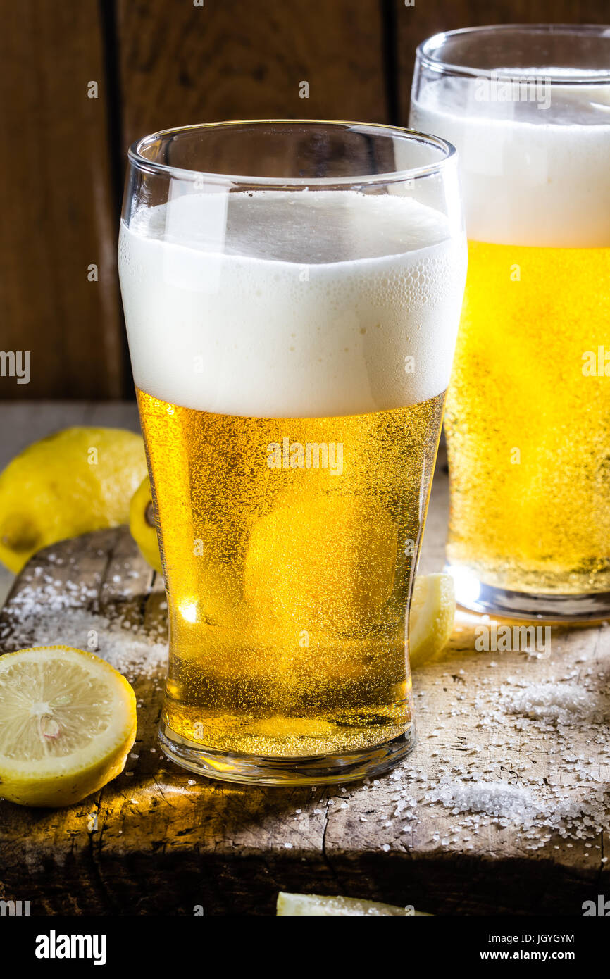 Ingredients for mexican chilean beer drink - Michelada. Beer, salt, lemon - Stock Image