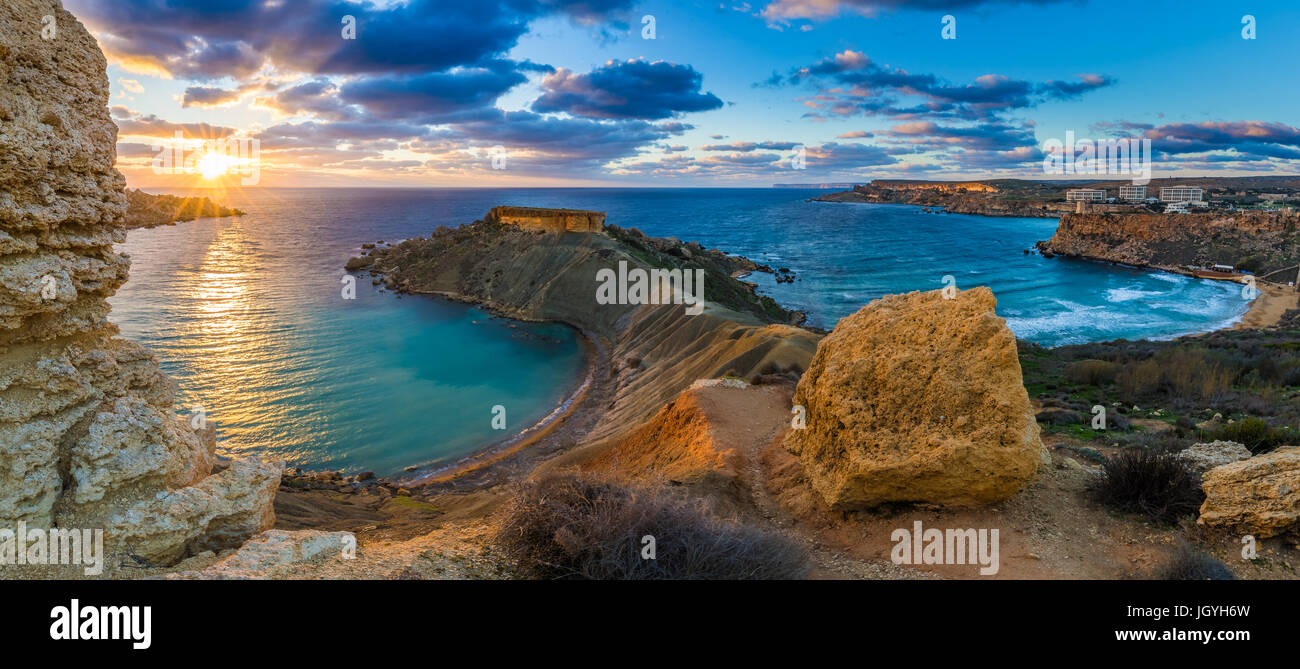 Mgarr, Malta - Panorama of Gnejna bay and Golden Bay, the two most beautiful beaches in Malta at sunset with beautiful - Stock Image