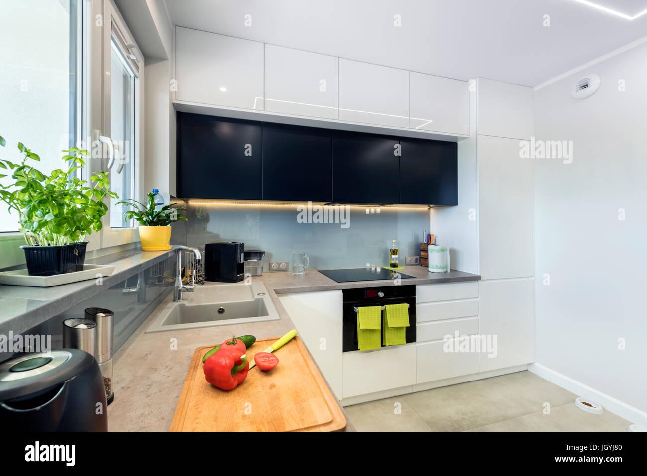 Modern kitchen interior design in white and black finishing Stock Photo