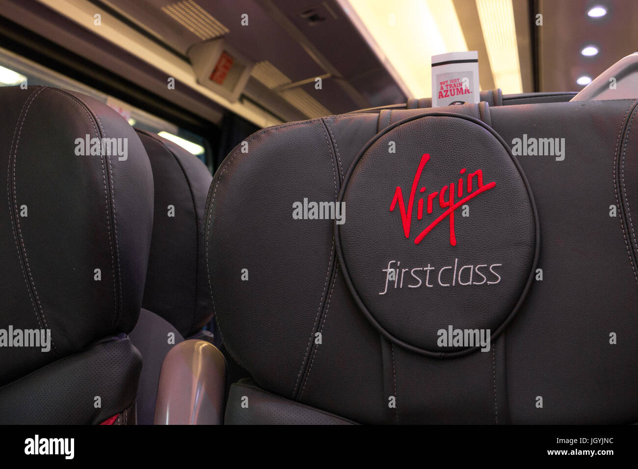 Close up of Virgin First Class logo brand on leather First Class seat, Virgin East Coast mainline between London - Stock Image