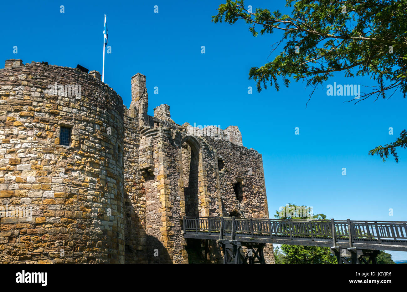 View of high stone walls, main gate over moat, 12th century medieval Dirleton Castle, East Lothian, Scotland, UK, - Stock Image