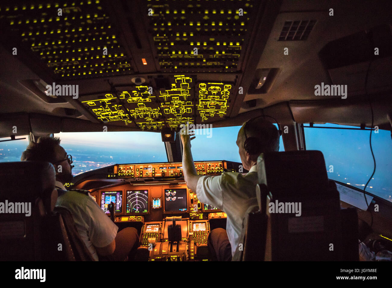 Two Pilots Departing out of Dallas Fort Worth Airport. Crew resource management taking place, both working together. - Stock Image