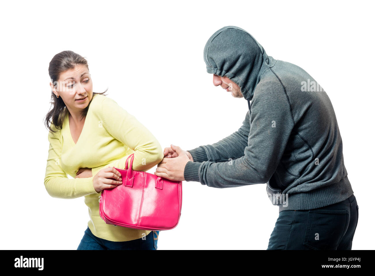 Girl with a pink bag became a victim of a robber, a portrait on a white background - Stock Image