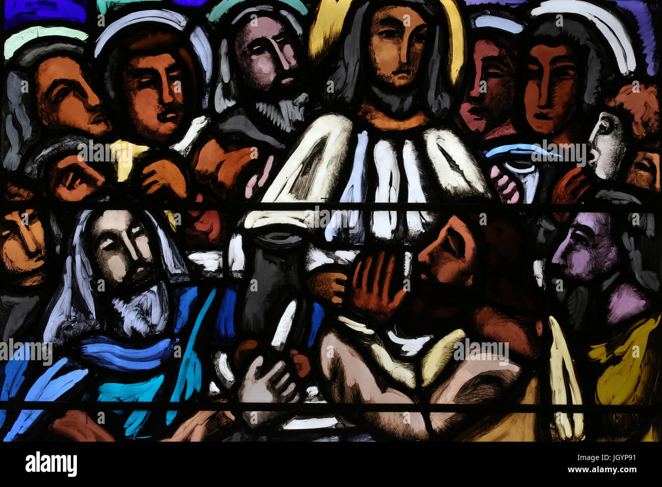 Saint-Joseph church.  Stained glass window. The Last Supper. The final meal that Jesus shared with his Apostles - Stock Image