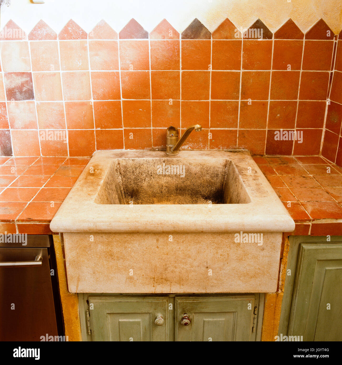 Distressed kitchen sink - Stock Image