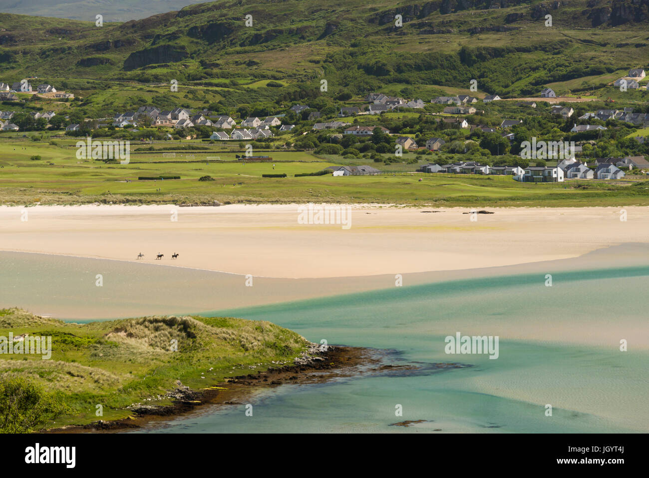 Three horses and riders crossing the beach at Dunfanaghy County Donegal Ireland - Stock Image
