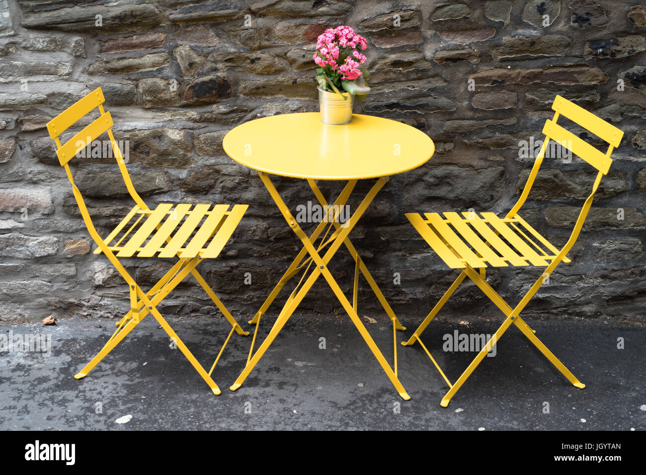 Brilliant Empty Bright Yellow Cafe Tables And Chairs Against An Machost Co Dining Chair Design Ideas Machostcouk