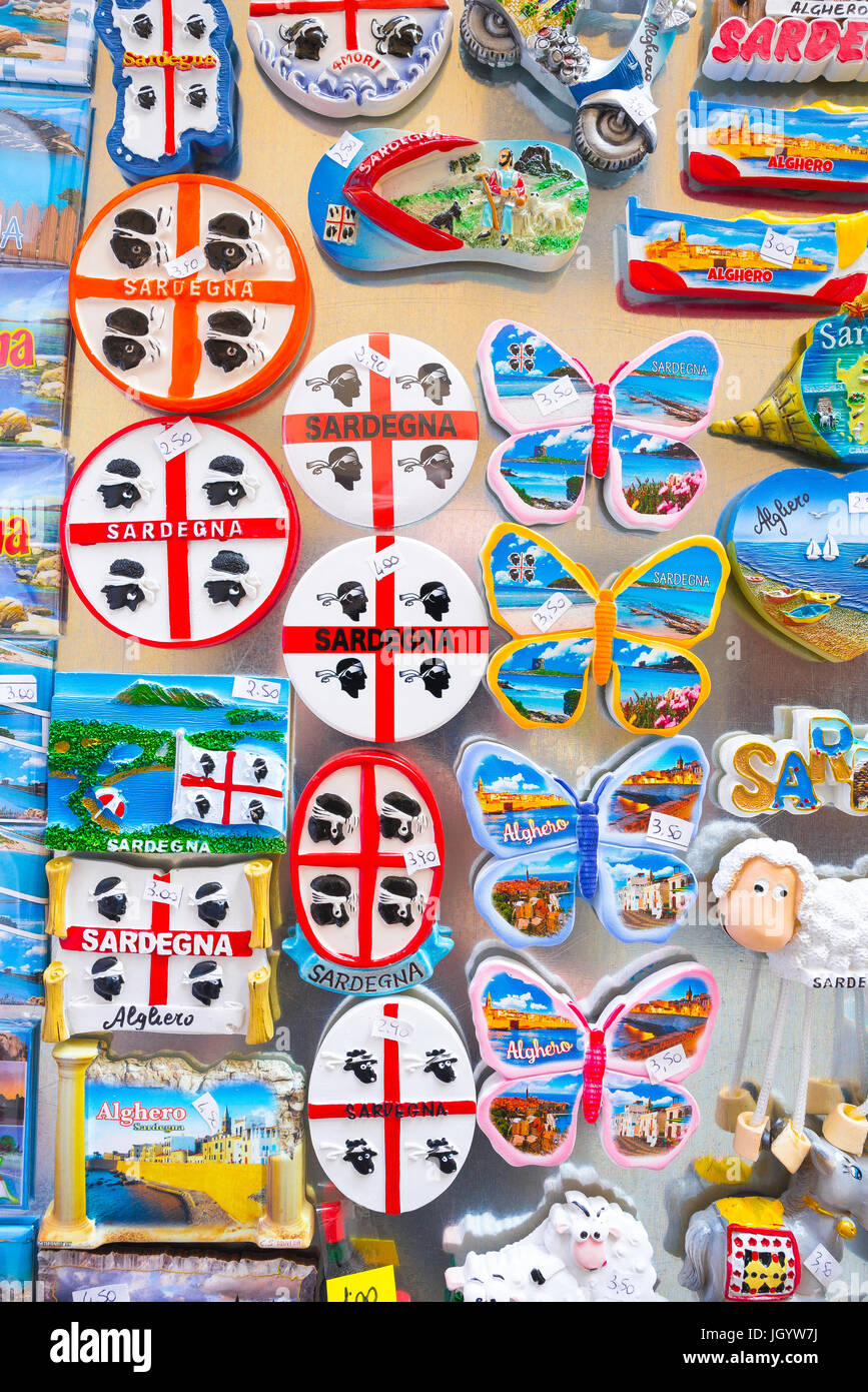 Sardinia souvenirs, a display of colourful souvenirs on sale outside a shop in the old town quarter of Alghero, - Stock Image