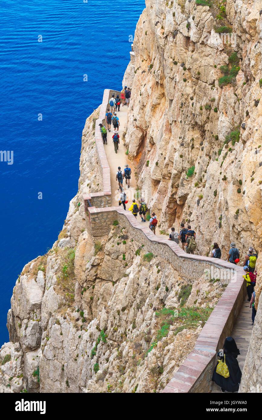 Grotta di Nettuno Sardinia, tourists head for the entrance to the Grotta di Nettuno near Alghero by way of the 654 - Stock Image