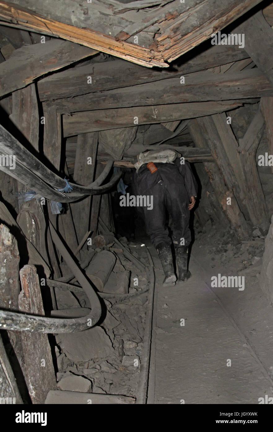 Miner walks through unstable mine shaft in Potosi, Bolivia - Stock Image