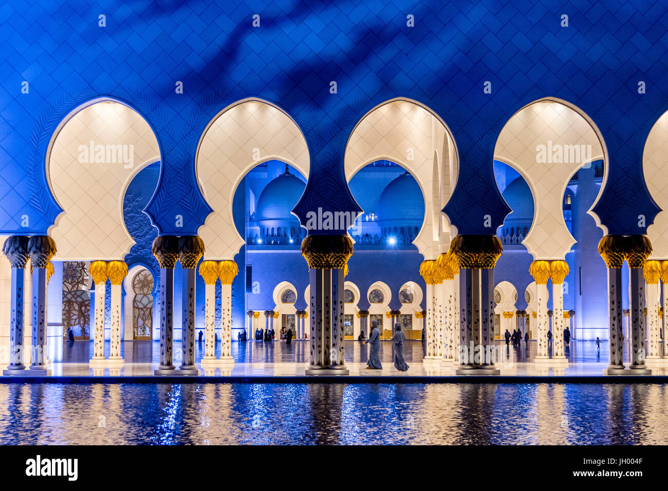 Emirati woman taking a selfie at the Sheikh Zayed Grand Mosque in Abu Dhabi, UAE Stock Photo