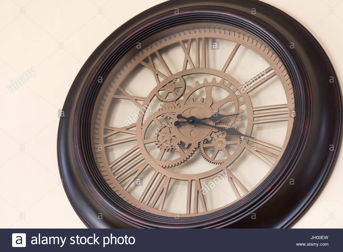A Dark Wooden Clock Face With Exposed Gears And Roman Numerals - 3-roman-numerals-clocks