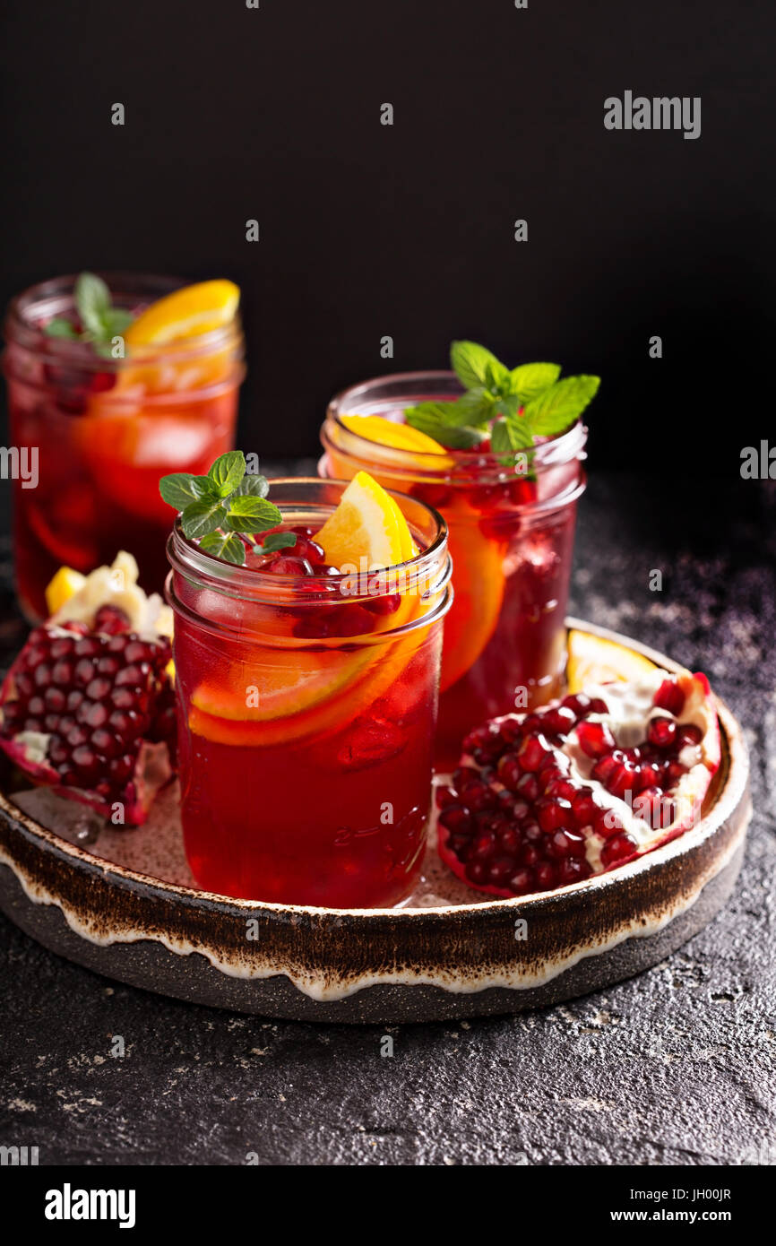 Pomegranate sangria with oranges - Stock Image