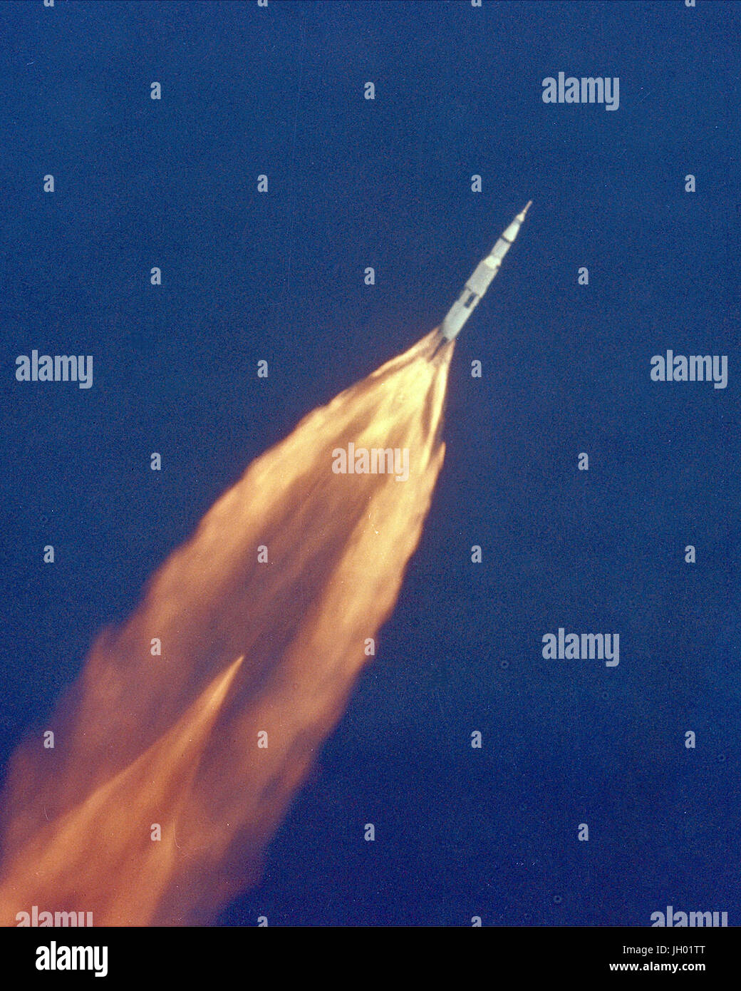 The Apollo 11 Saturn V space vehicle climbs toward orbit after liftoff from Pad 39A at 9:32 a.m. EDT. In 2 1/2 minutes - Stock Image