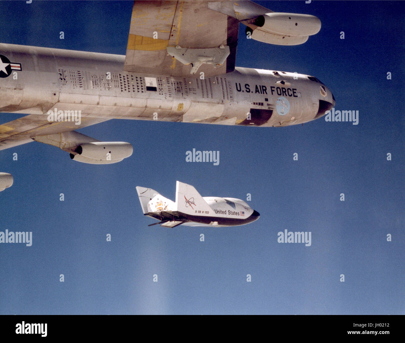 The X-38 research vehicle drops away from NASA's B-52 mothership immediately after being released from the B - Stock Image