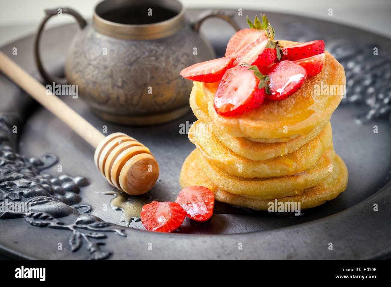 Stack of sweet pancakes with strawberry and honey. Gluten free flour. Stock Photo