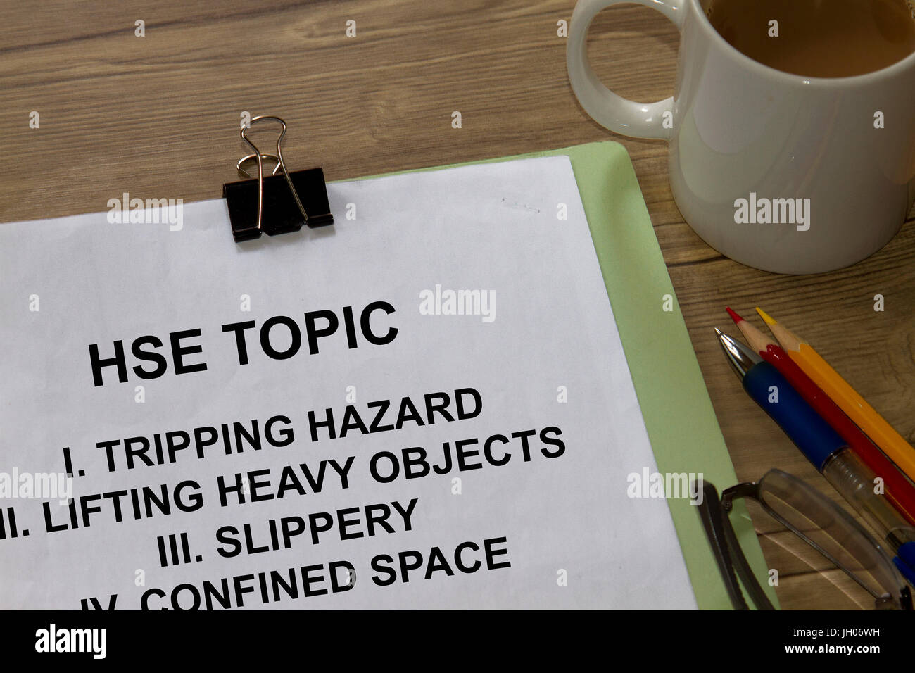 Health safety and environment topic with coffee and table. - Stock Image