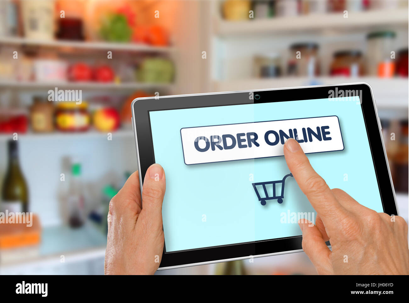 75617f5ea Online Supermarket Shopping Hands with computer tablet shopping cart icon  in front of refrigerator - Stock