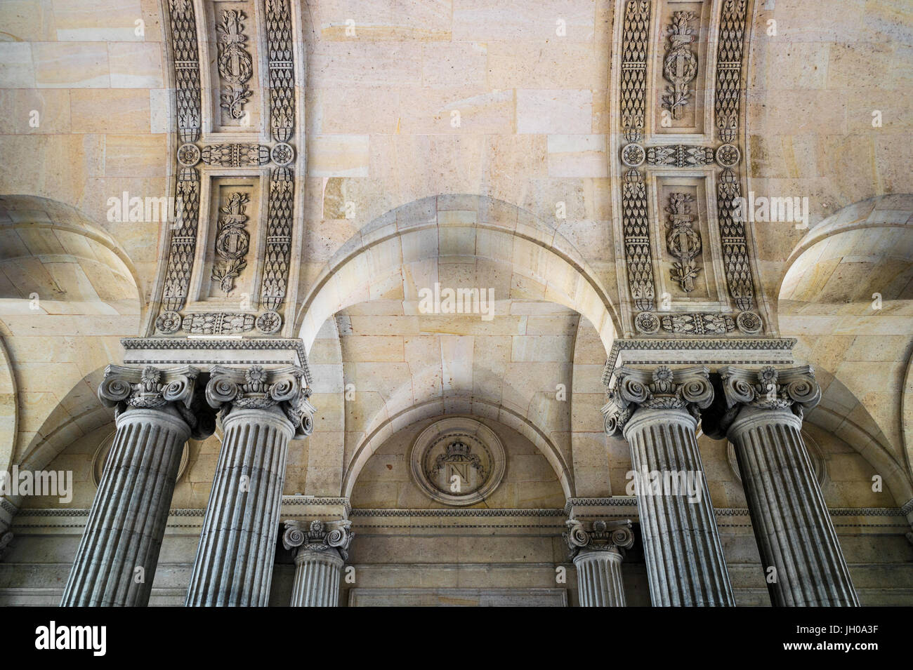 PARIS, FRANCE - JUNE 21, 2017: Cross vaulted ceiling with sculpted columns and Napoleon emblem. - Stock Image