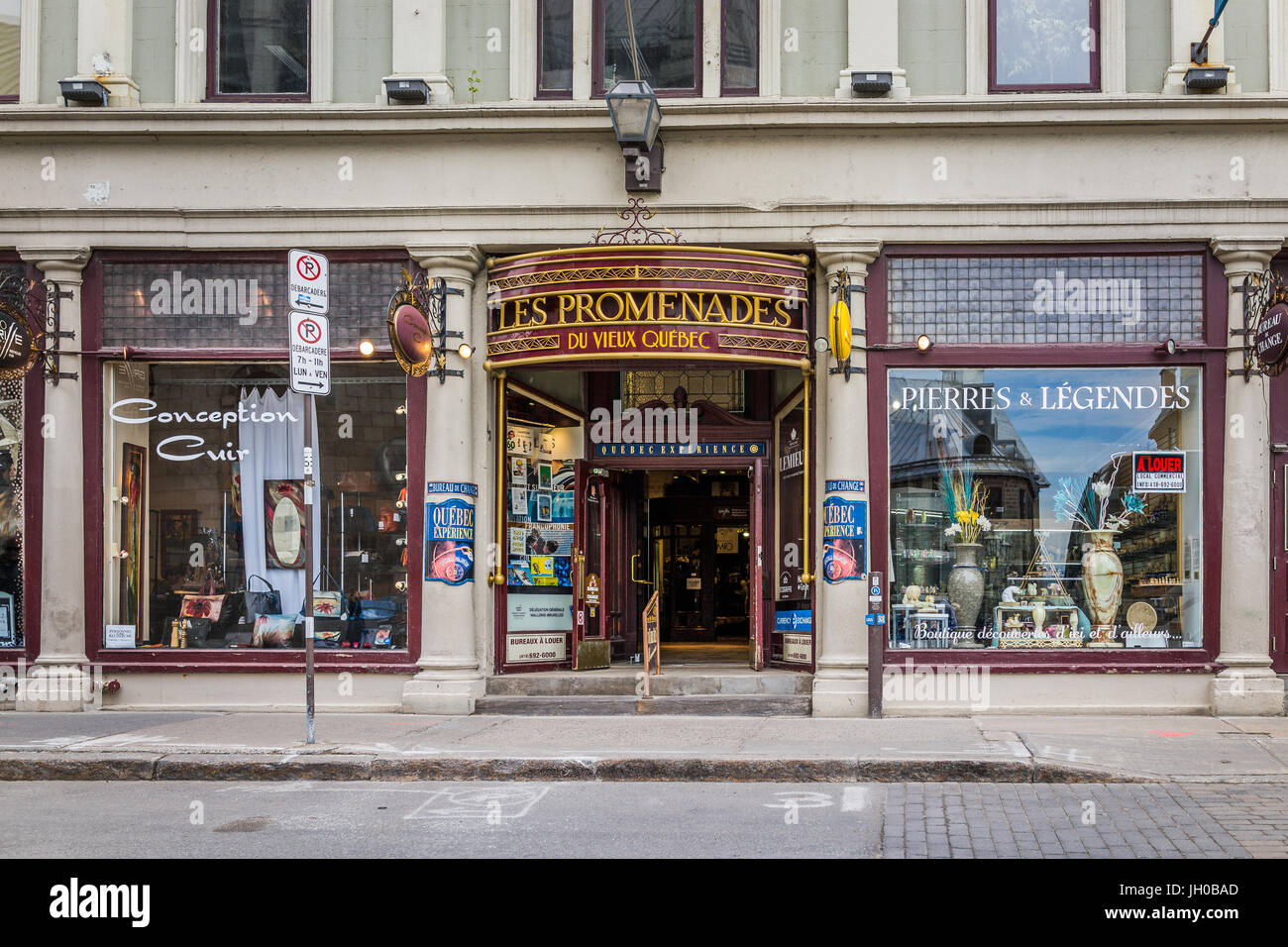 Quebec City, Canada - May 29, 2017: Old town street with shops and stores called Les Promenades with stone wall - Stock Image