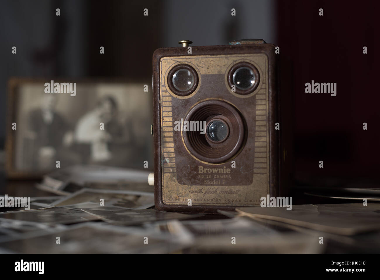 Old Kodak brownie camera with old black and white family