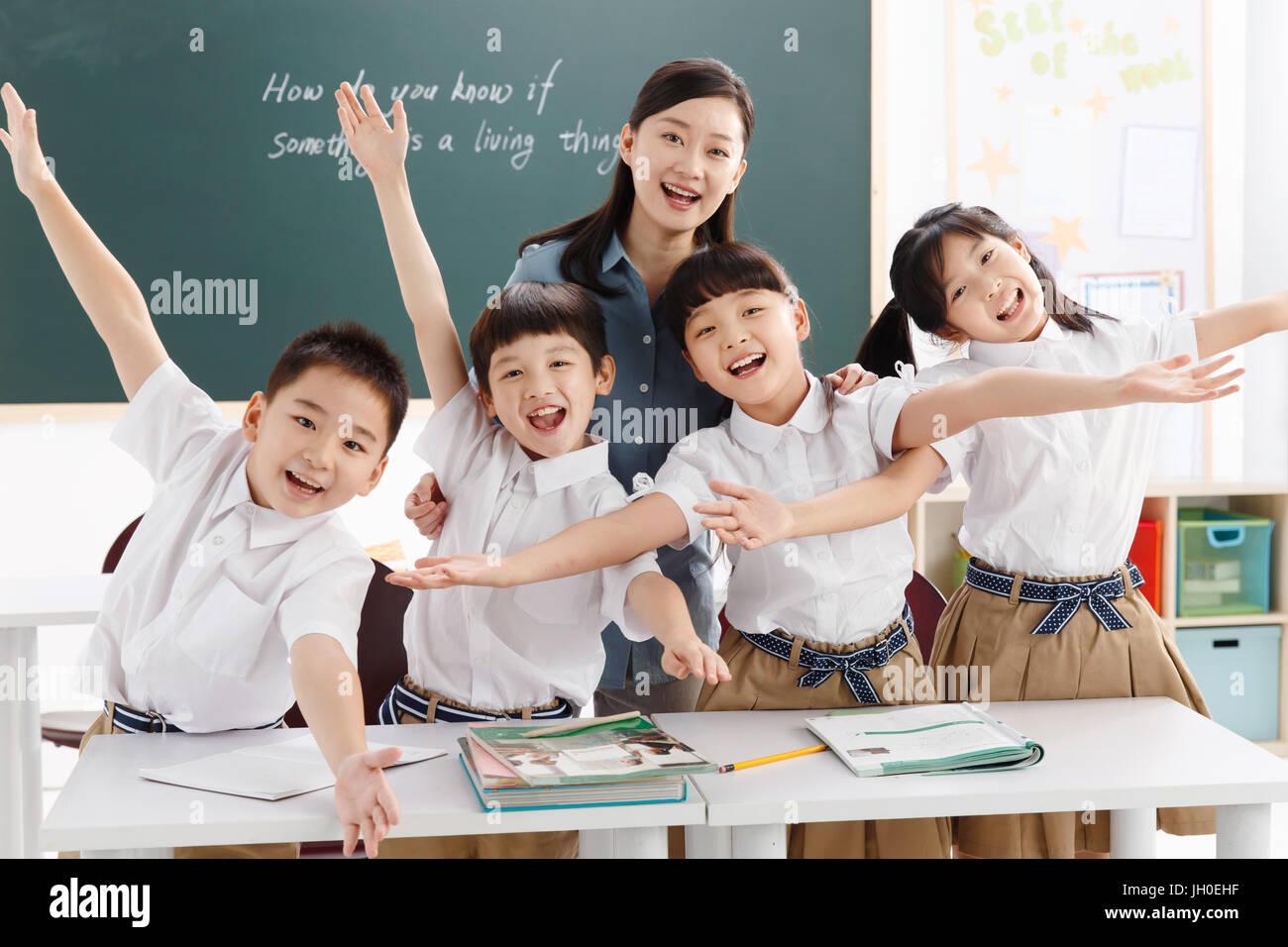 Elementary student greeting teacher stock photos elementary teacher with elementary school students stock image m4hsunfo