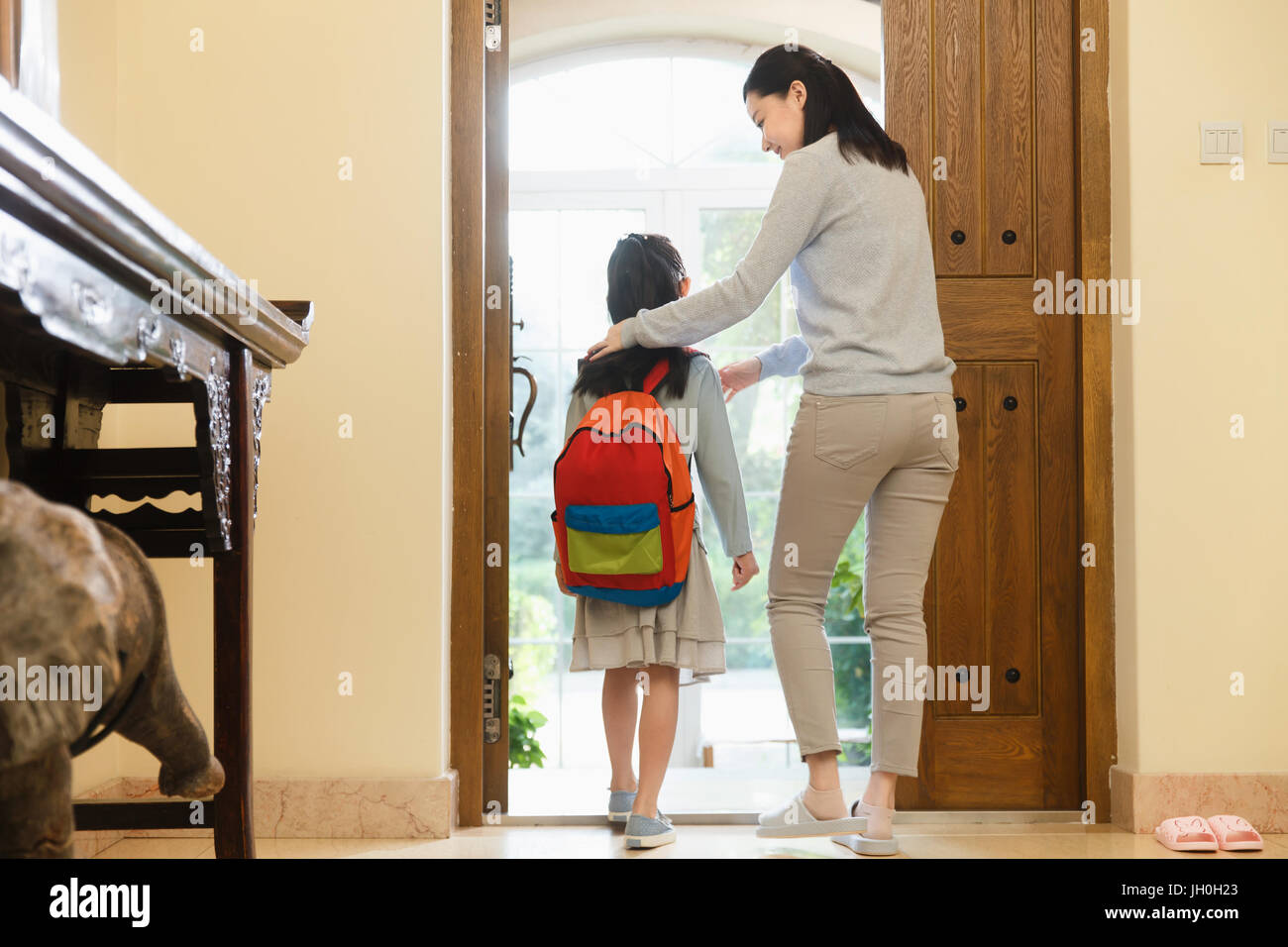 Daughter and mother at home - Stock Image