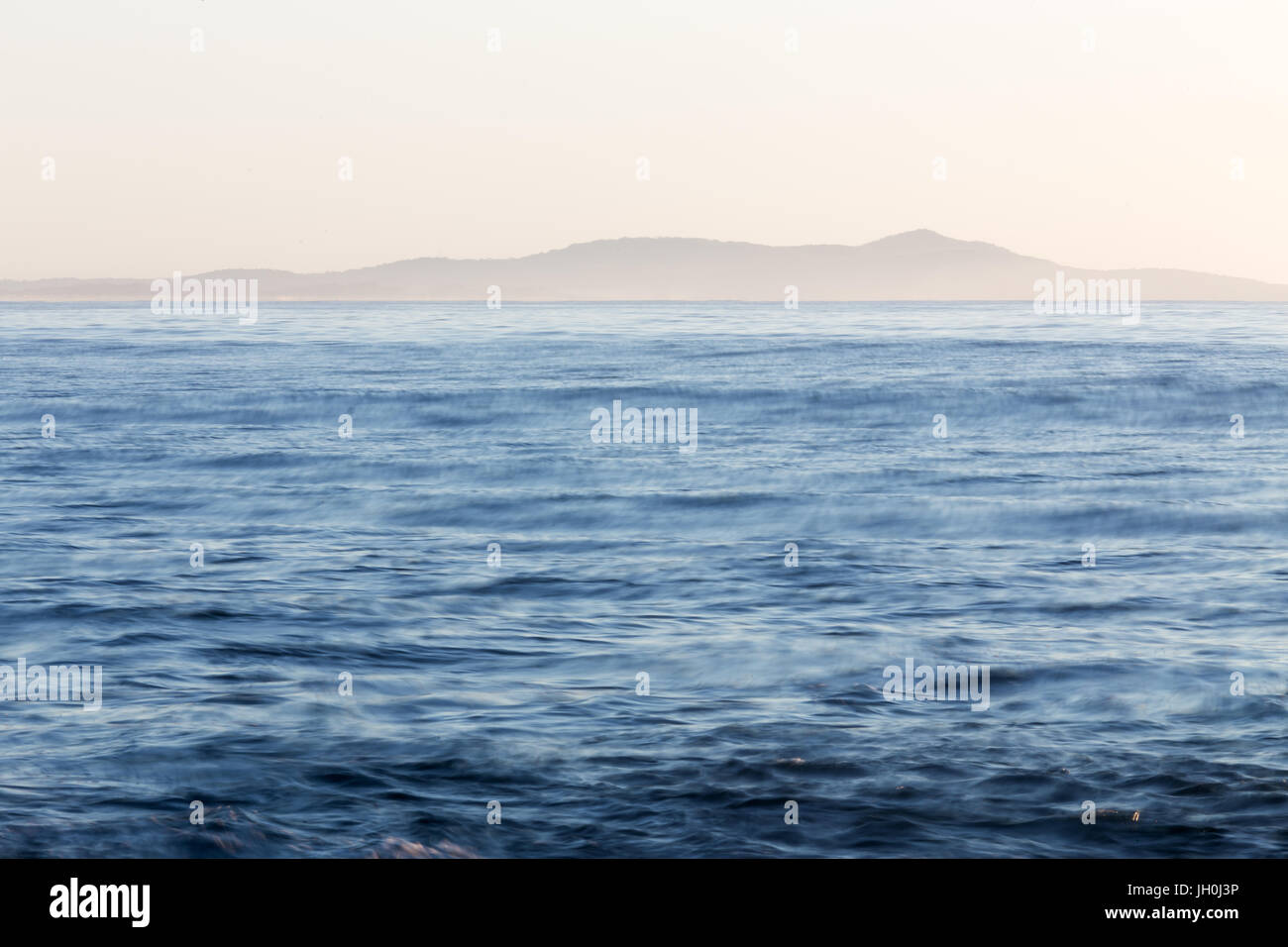An empty body of ocean and a distant land mass on the east coast of Australia. - Stock Image