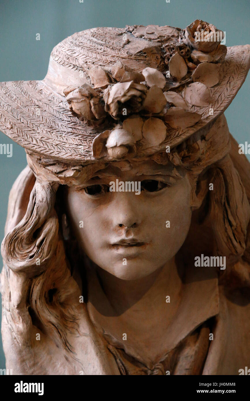 Rodin museum, Paris. Young girl with flowers on her hat. Baked earth. c. 1870-1875. France. - Stock Image