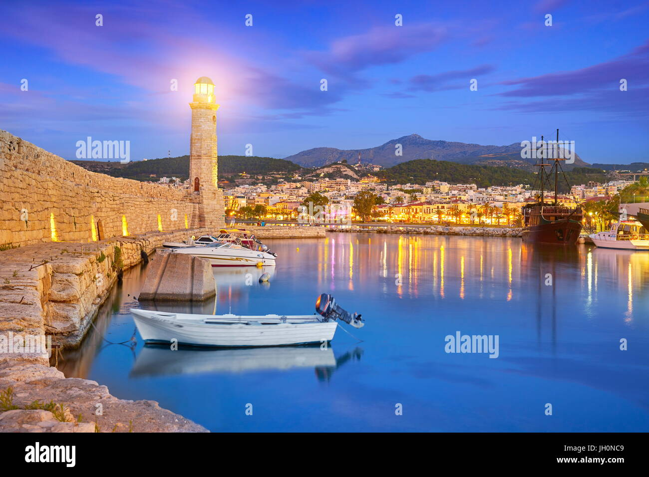 Crete Island - Lighthouse at Old Venetian Port, Rethymno, Greece - Stock Image