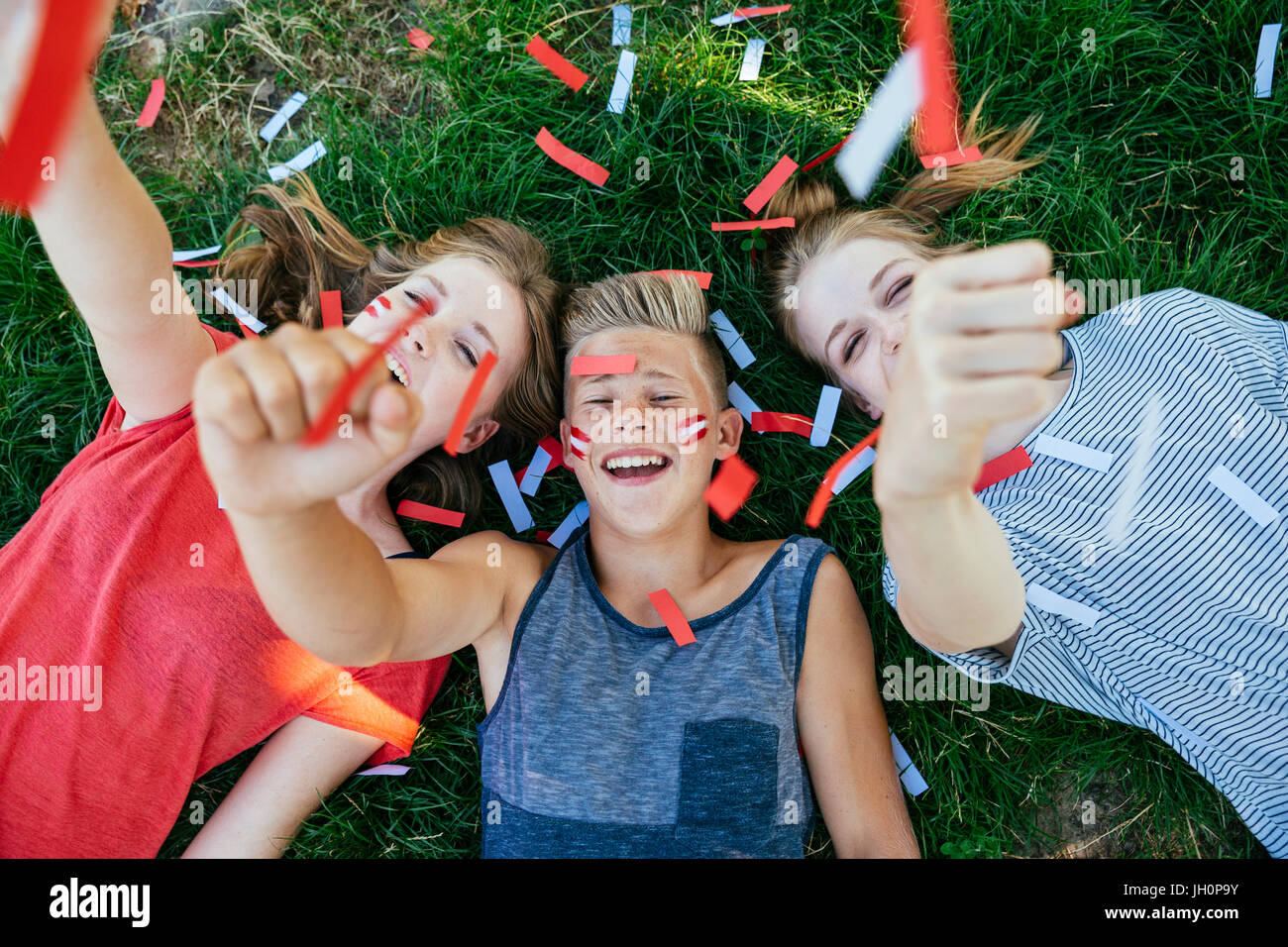 Austria Fans with colours in face celebrating together, Vienna, Austria Stock Photo