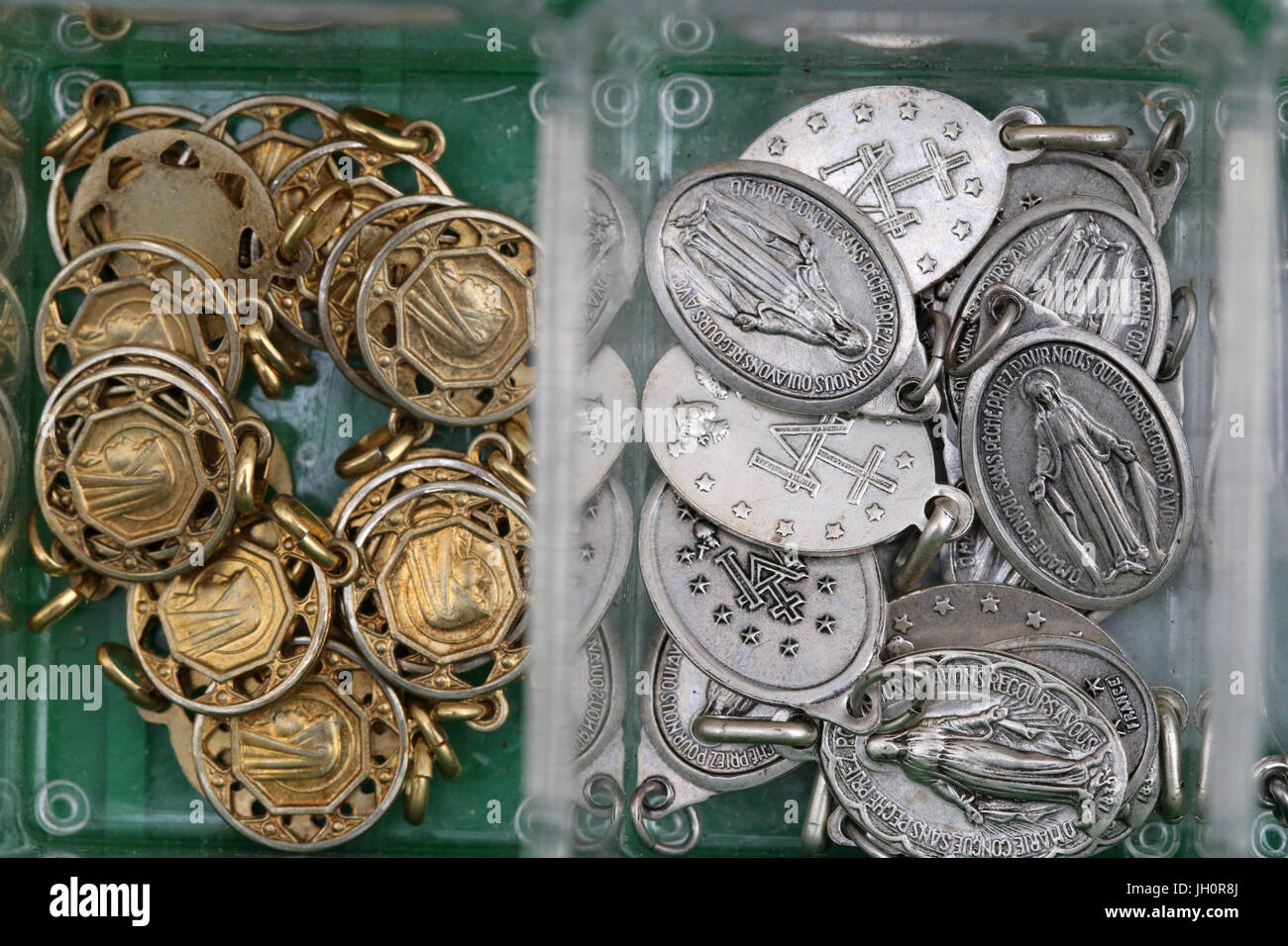 Christian medals for sale.  France. - Stock Image