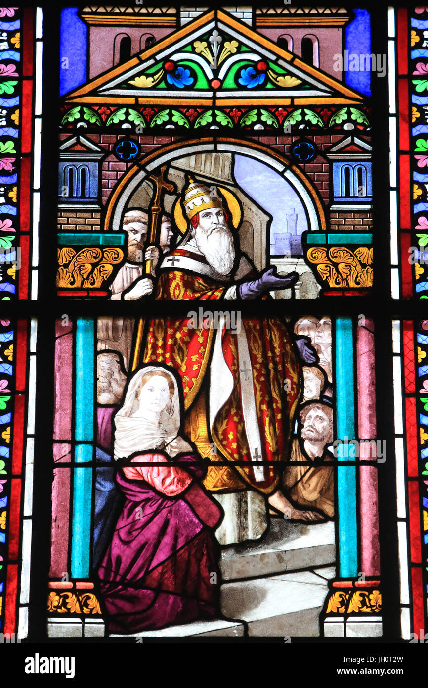 St. Catherine of Siena tries to convince Pope Gregory XI to leave Avignon for Rome. Stained glass of the nave made - Stock Image