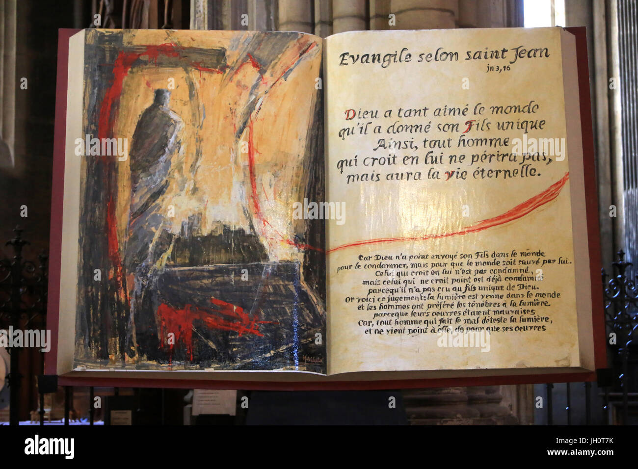 Gospel according to Saint John on a lectern. Lyon Cathedral. France. - Stock Image