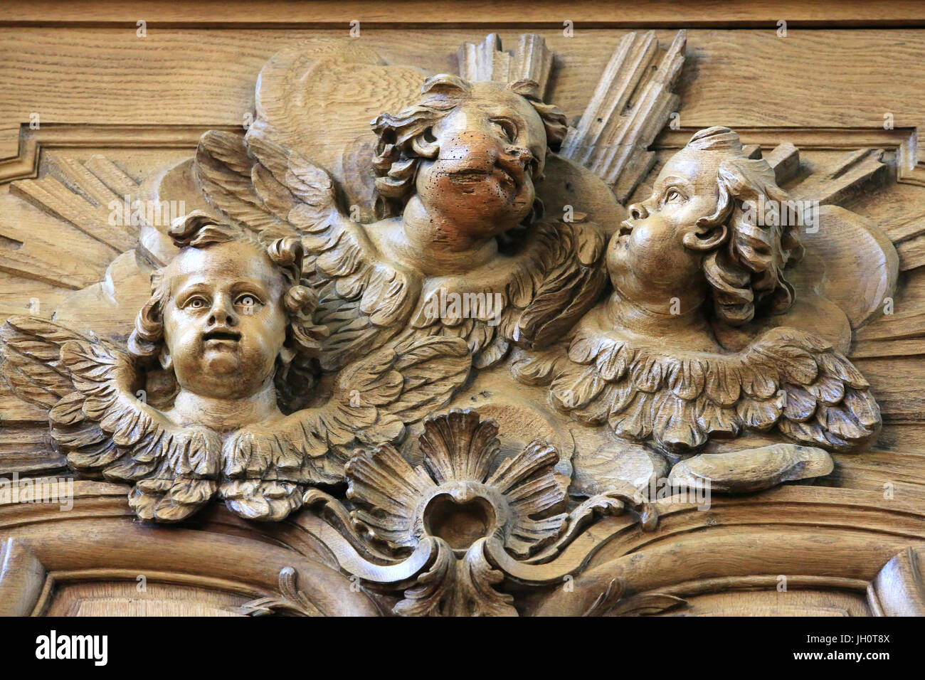 Cherubs. Details of the cornice of the stalls. St. Bruno les Chartreux's church. Lyon. France. - Stock Image