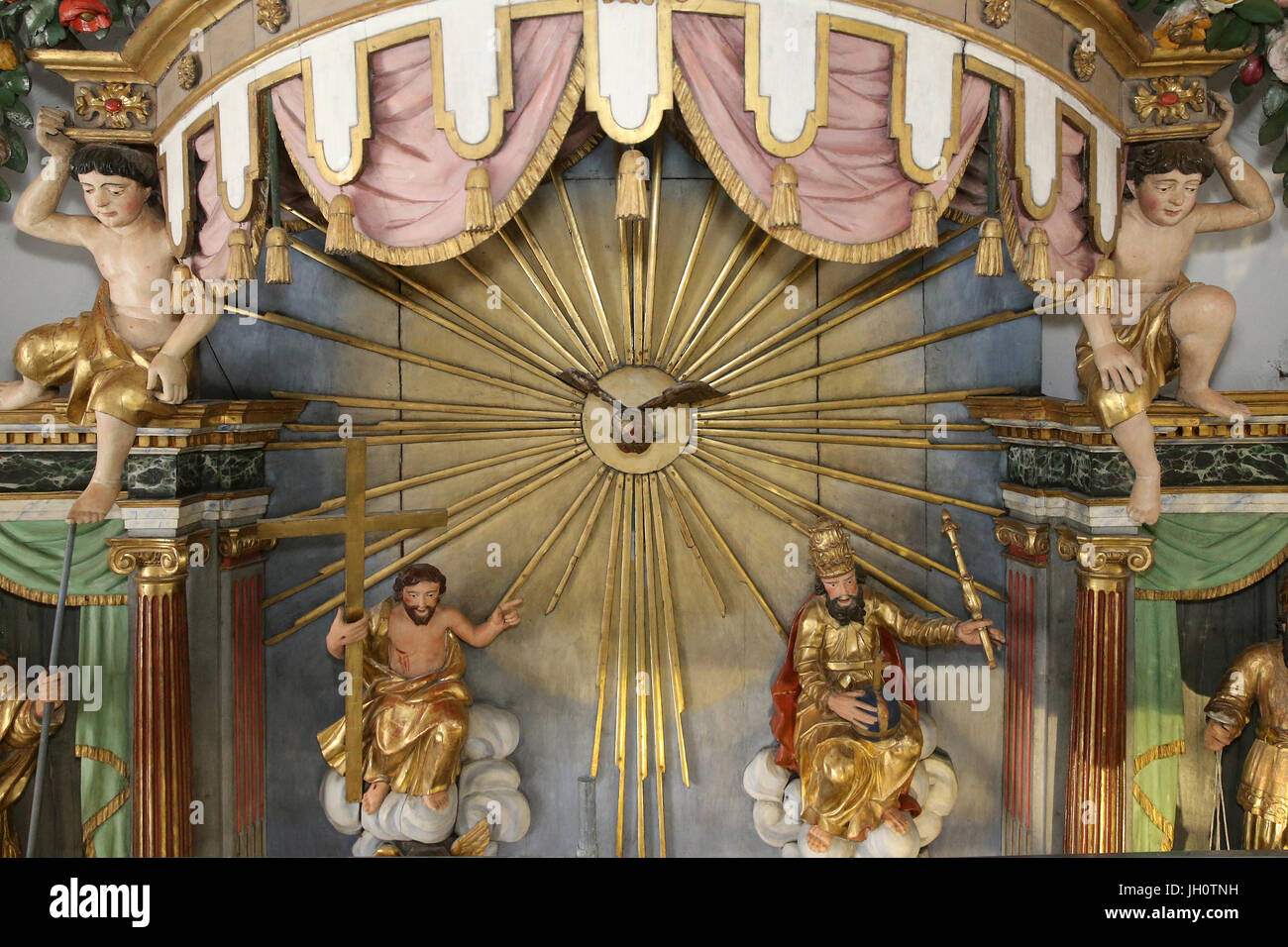 Restoration of Saint Gervais baroque church.  Holy Trinity: God, Jesus Christ,  Holy Spirit.  Paint renovation. - Stock Image
