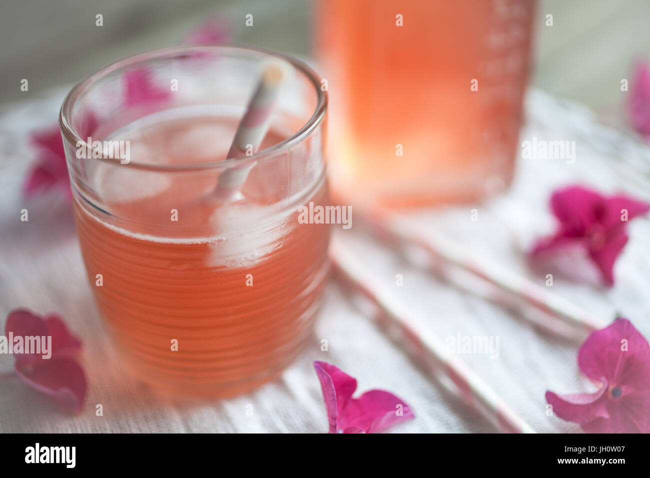 Homemade juice with rhubarb and strawberries - Stock Image