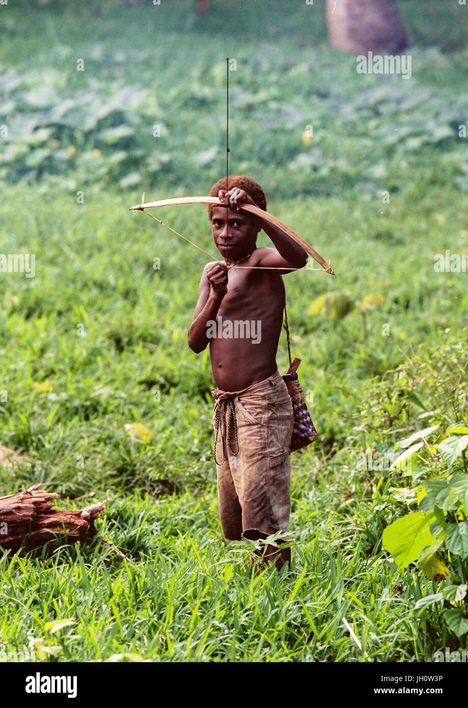 Portrait of a boy hunting with a bow, Malampa Province, Malekula Island, Vanuatu - Stock Image