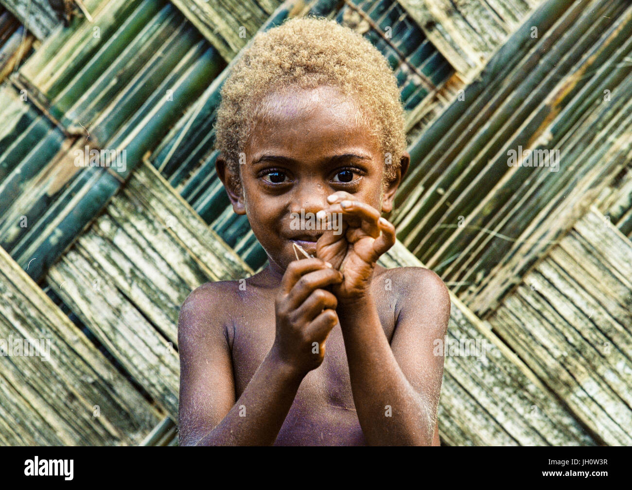 Portrait of a boy with blonde hair, Malampa Province, Malekula Island, Vanuatu - Stock Image