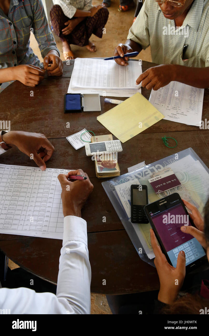 AMK microfinance and CARD (Council for agricultural and rural development) disbursing funds for beneficiaries of - Stock Image