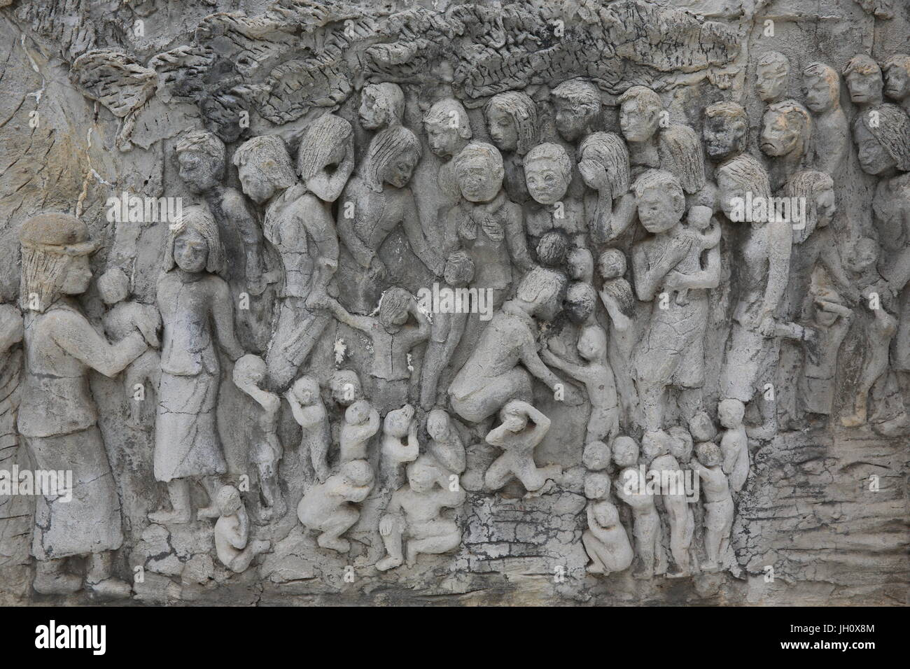 Memorial shrine festooned with bas-reliefs of Khmer Rouge atrocities at Wat Somrong Knong. Cambodia. - Stock Image