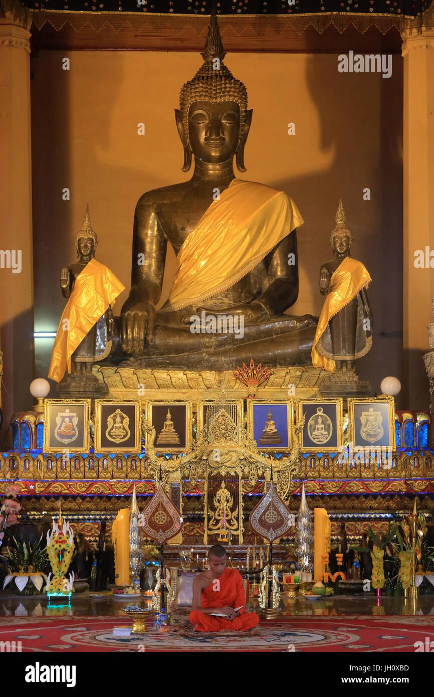 Buddha. Bhumisparsha-Mždra. The three Phra Ong Teu Buddhas. Vat Ong Teu. Wat Ong Teu Mahawihan. Vientiane. Laos. - Stock Image
