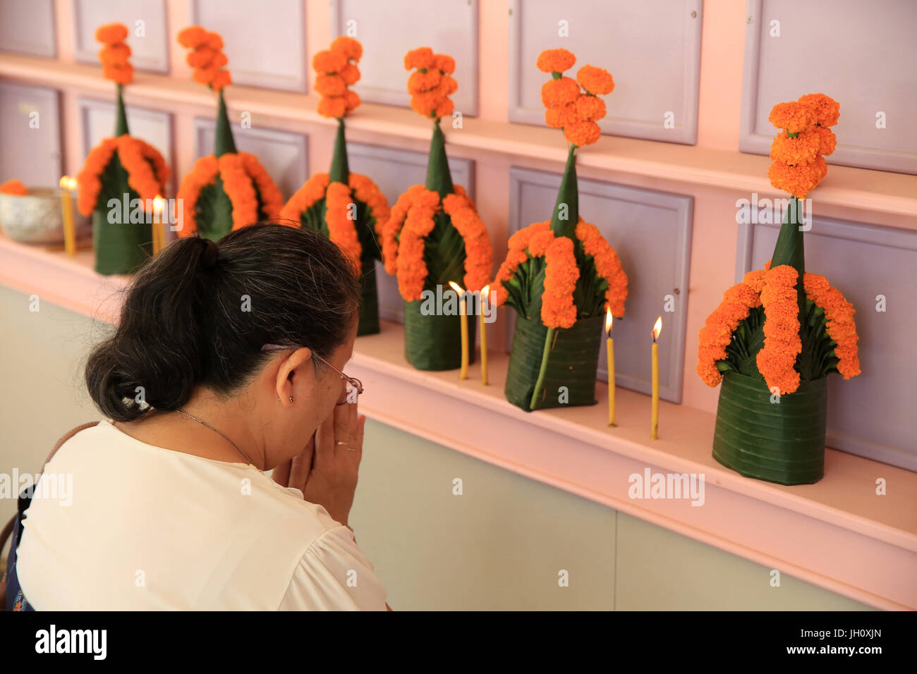 Cult of the dead. Laotian praying. Wat Naxai. Vientiane. Laos. - Stock Image