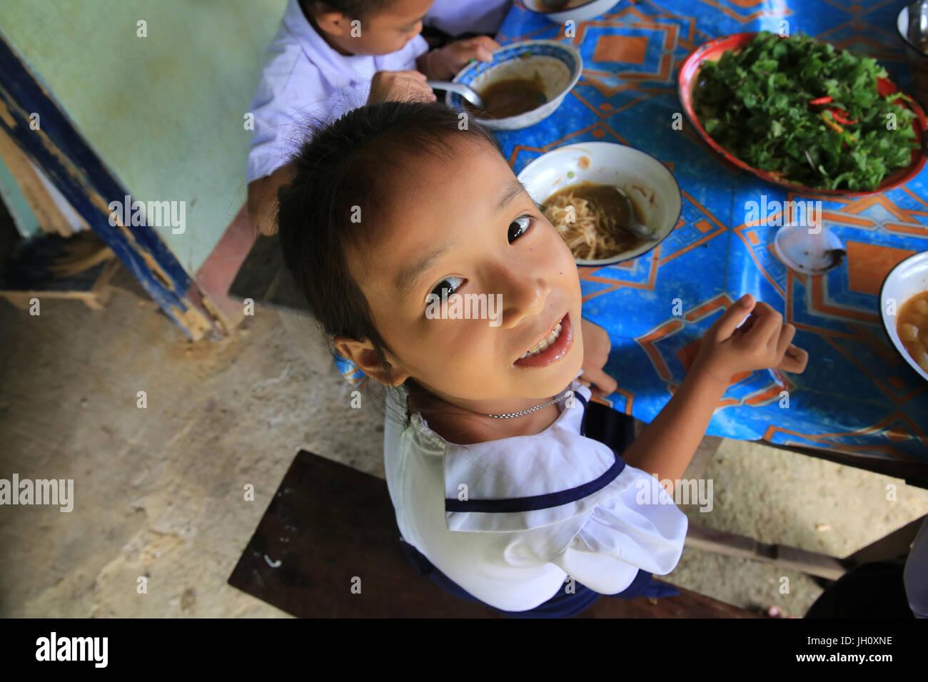 Meal. Laotian schoolgirl.  Laos. - Stock Image