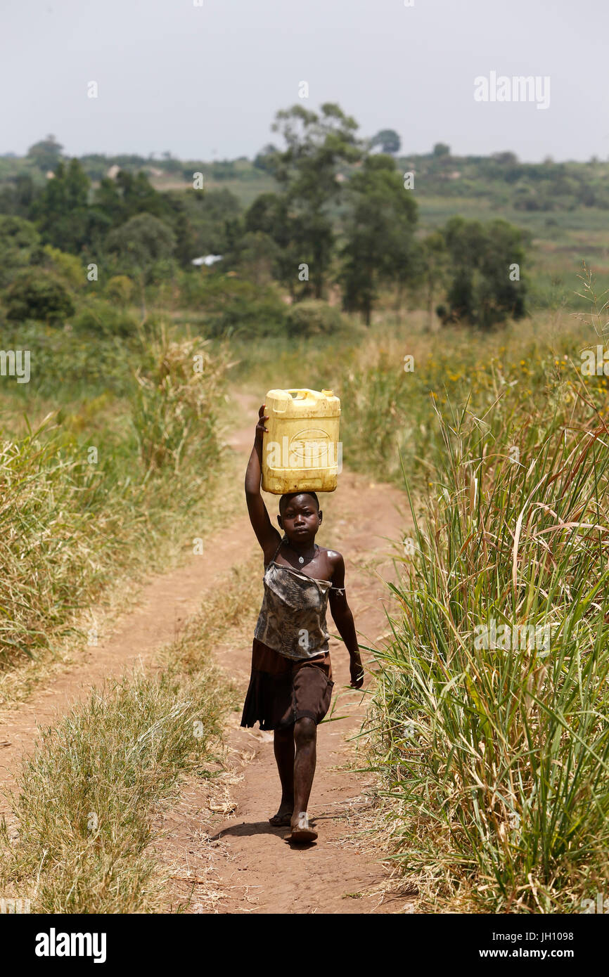 Ugandan child fetching water. Uganda. - Stock Image