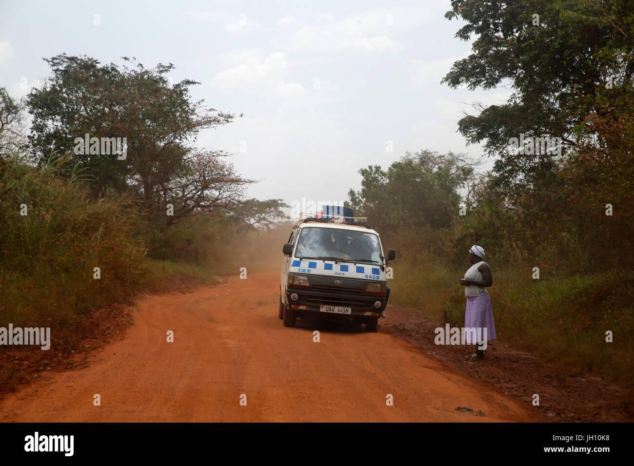 Minibus on an African road. Uganda. - Stock Image