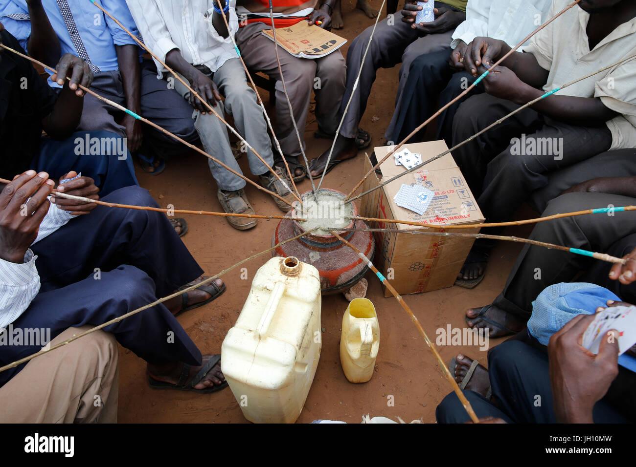 Ugandan villagers drinking home-brewed beer. Uganda. - Stock Image