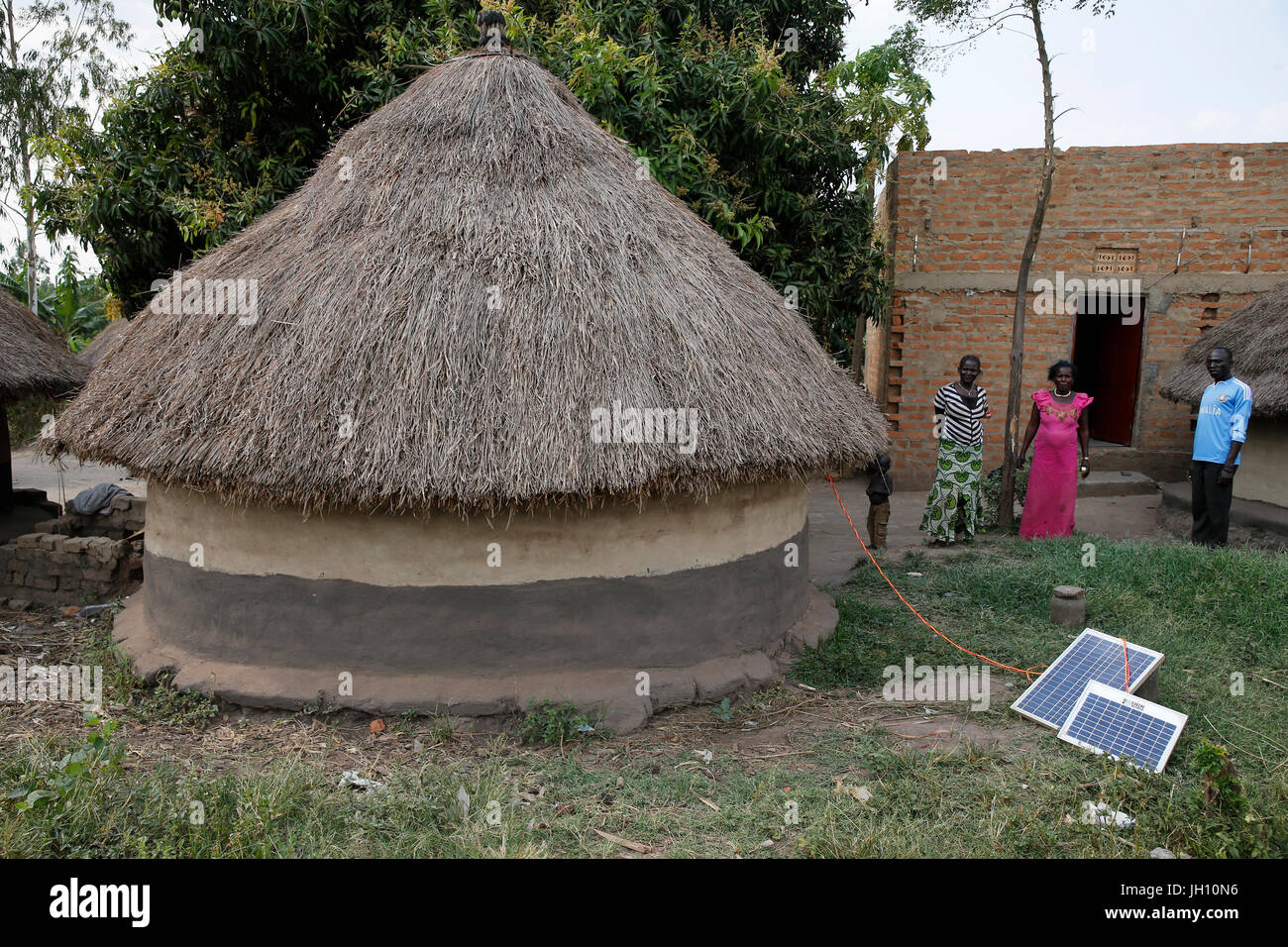 Solar panels outside a hut. Uganda. - Stock Image