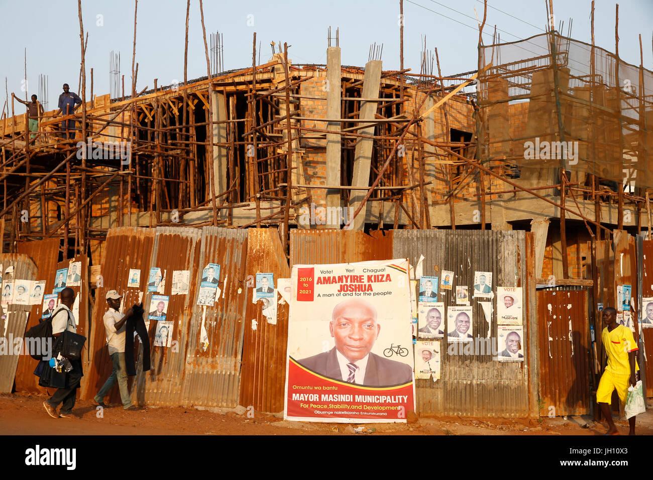 Election poster and scaffolding in Masindi. Uganda. - Stock Image
